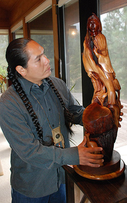 "Photo credit - Madera Tribune - Alex with manzanita carving ""Buffalo Song"""